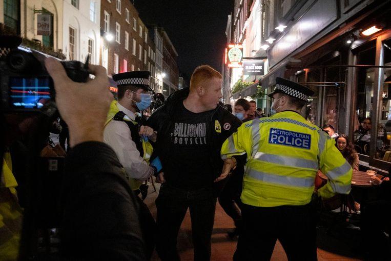 Anti-lockdown demonstranten in Londen.  Beeld Photo News