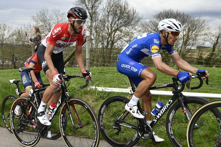Philippe Gilbert (R), Jelle Vanendert (C) en Enrico Gasparotto(L) tijdens de Amstel Gold Race. Beeld BELGA