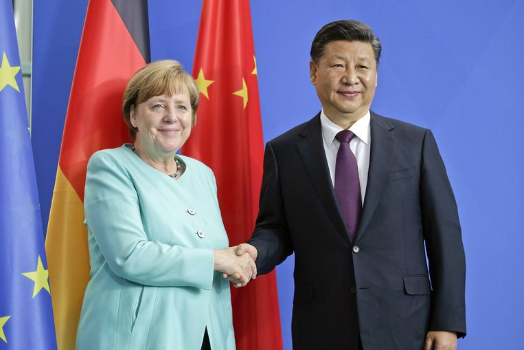 Angela Merkel en Xi Jinping. Beeld Photo News