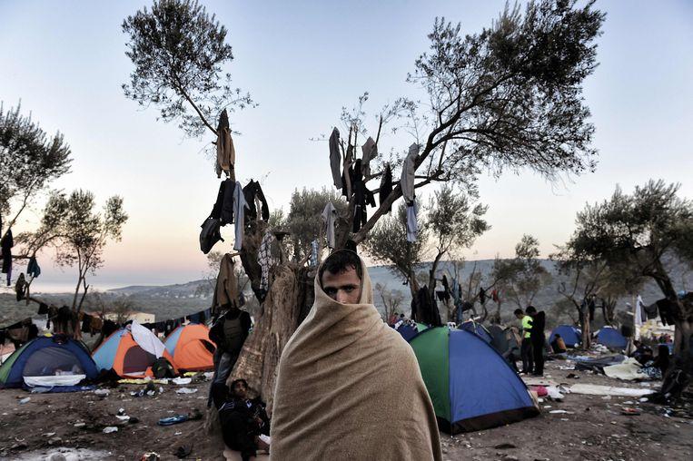 Vluchtelingen in het opvangkamp. Beeld AFP