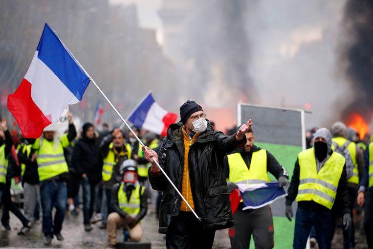Demonstranten van de gele-hesjesprotestbeweging afgelopen weekend in Parijs. Beeld Getty Images