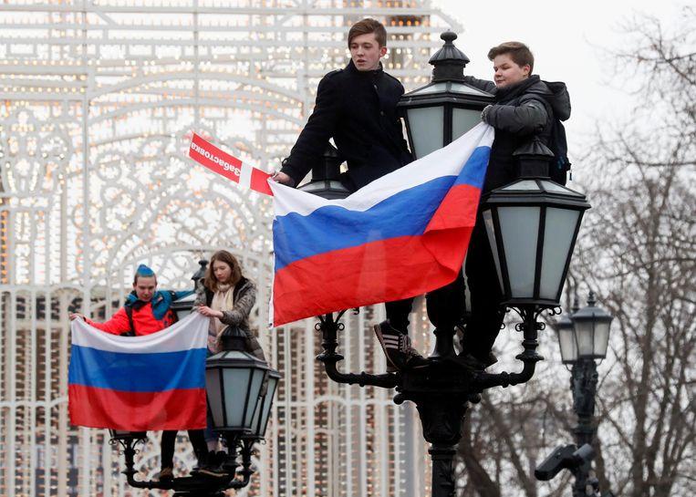 Demonstranten in het centrum van Moskou. Beeld afp