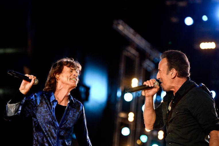 Springsteen op het podium samen met Rolling Stones-zanger Mick Jagger. Beeld AFP