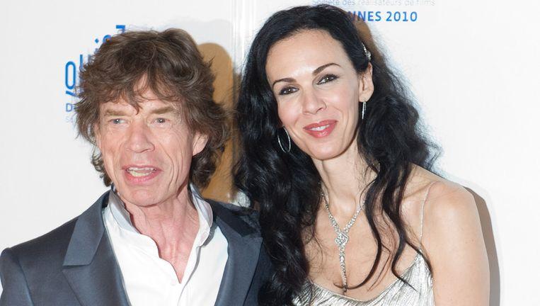 Mick Jagger in gelukkiger tijden met zijn vriendin L'wren Scott Beeld belga