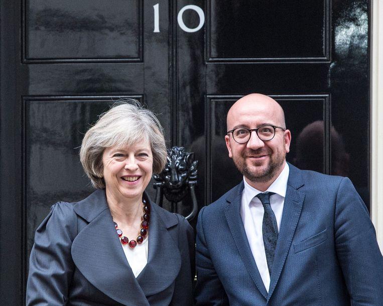 Premier Michel met de Britse premier Theresa May. Beeld Photo News