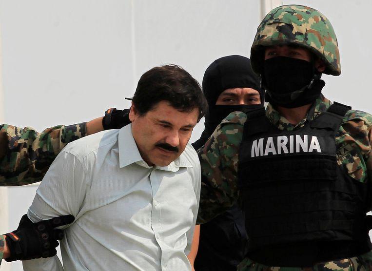 Joaquín 'El Chapo' Guzmán wordt in 2014 voor de tweede keer gearresteerd, in Mexico. Een jaar later zou hij voor de tweede keer ontsnappen. Beeld REUTERS