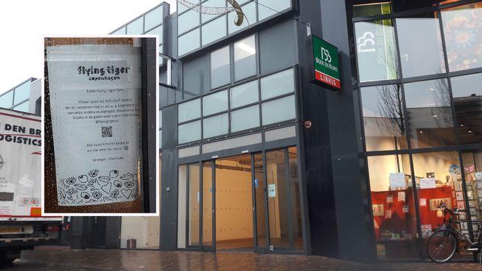 Bericht op de deur van de voormalige winkel van Flying Tiger in het centrum van Ede.