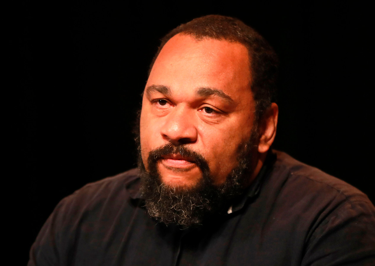 (FILES) In this file photo taken on May 20, 2017, French controversial humorist Dieudonne M'bala M'bala looks on during a press conference at the Theatre de la Main d'Or in Paris. - Dieudonné on July 5, 2019 was sentenced to two years in prison for tax fraud, abuse of corporate assets and money laundering. (Photo by JACQUES DEMARTHON / AFP)