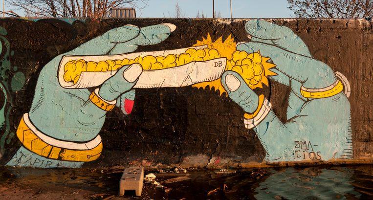 Streetart van Delicious Brains Beeld Kees Kamper