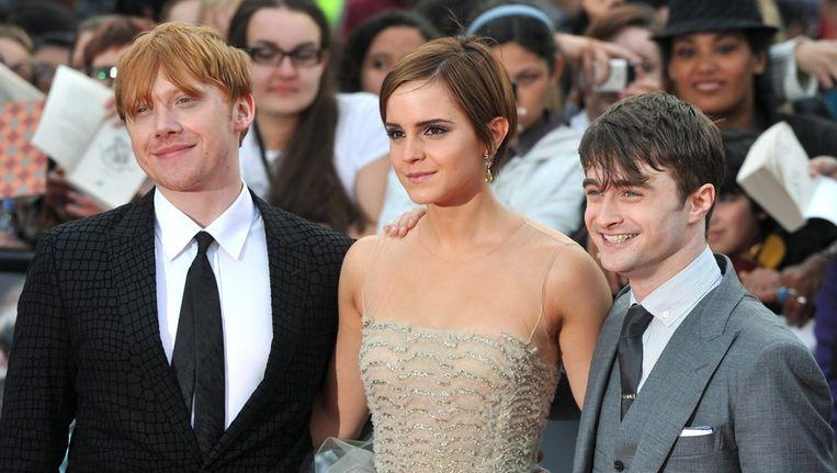 Rupert Grint (links), Emma Watson (midden), Daniel Radcliffe (rechts) bij aankomst van de première van 'Harry Potter And The Deathly Hallows: Part 2'. Beeld epa