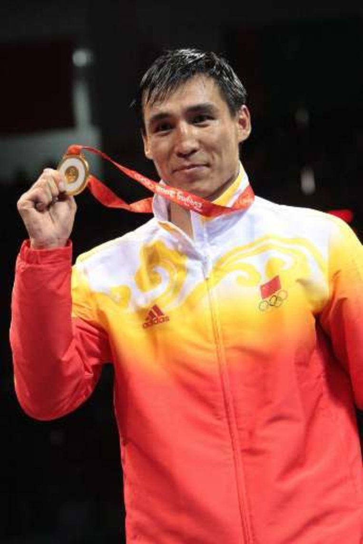 Zhang Xiaoping, goud bij de halfzwaargewichten. Beeld UNKNOWN