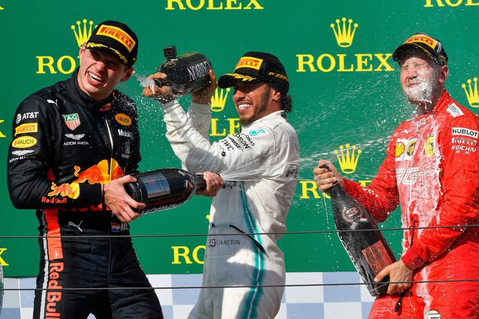 Max Verstappen, Lewis Hamilton en Sebastian Vettel vieren feest bij de GP van Hongarije.
