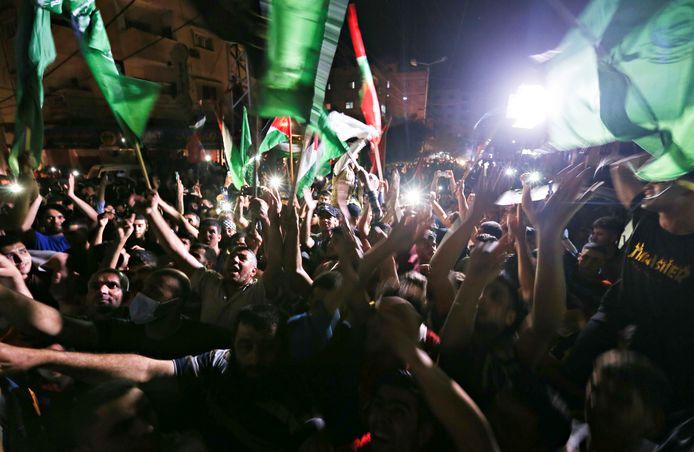 Palestijnen vieren het staakt-het-vuren als een overwinning op verschillende plaatsen in de Gazastrook.