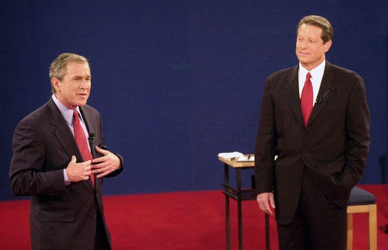 De toenmalige presidentskandidaten George Bush en Al Gore bij een debat in 2000. Beeld ap