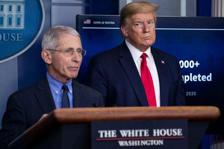Immunoloog Anthony Fauci en president Donald Trump tijdens een persconferentie over het coronavirus in april 2020. Beeld AP