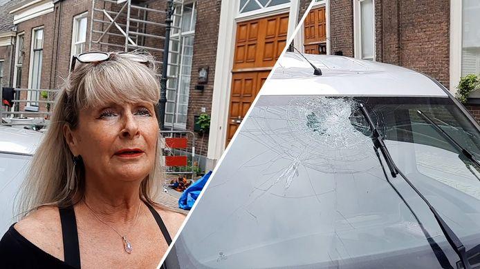 Jolanda Beugelaar en een van de beschadigde auto's in de Buiten Nieuwstraat.
