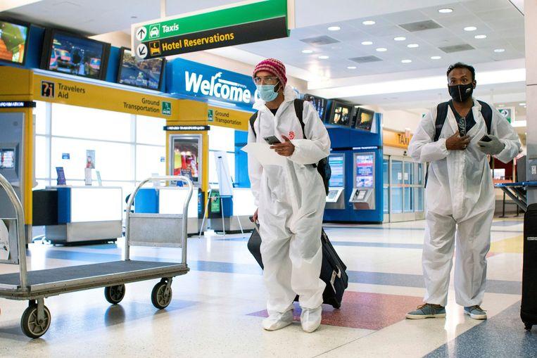 Reizigers op JFK International Airport in New York. Beeld REUTERS
