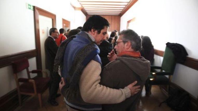Een homostel is aanwezig bij het debat van het parlement over het homohuwelijk. ANP Beeld