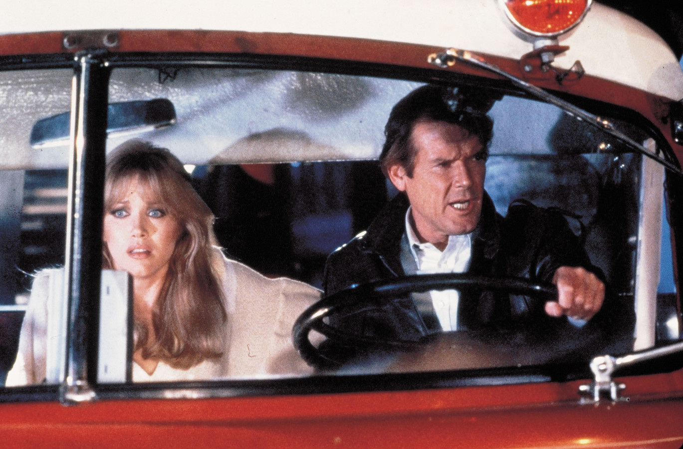 Tanya Roberts en Roger Moore.