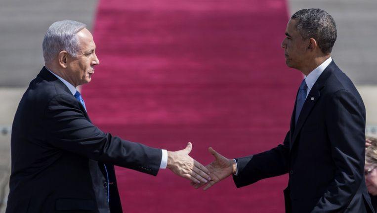 President Obama schudt de hand van Netanyahu tijdens een bezoek van de Amerikaanse president in Tel Aviv. Beeld ANP