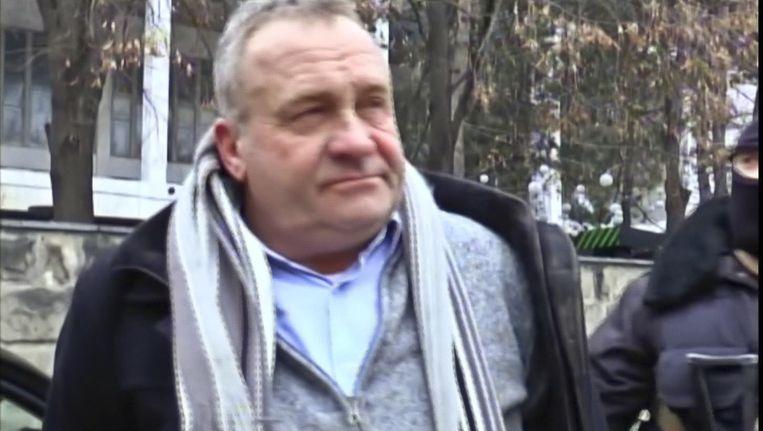 Smokkelaar Valentin Grossu in februari 2015, na zijn arrestatie in Chisinau. Beeld ap