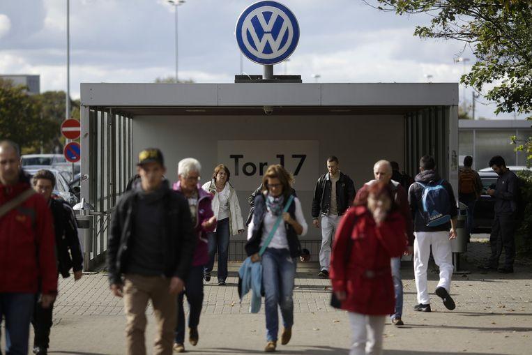 72.000 van de 120.000 inwoners van de stad Wolfsburg zijn er tewerkgesteld in 's werelds grootste autofabriek. Beeld Daniel Rosenthal / AP