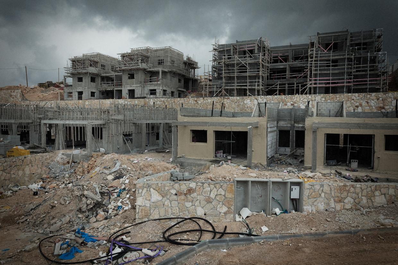 Nieuwe nederzettingen worden opgetrokken bij de Psagot wijnmakerij op de Westelijke Jordaanoever.  Beeld Daniel Rosenthal