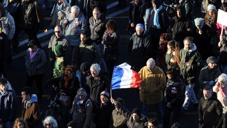 Een stille mars voor vrijheid en vrede en tegen de 'barbaarsheid' bracht zaterdag in Toulouse meer dan 10.000 mensen op de been. Beeld AFP