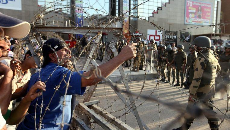 Morsi-aanhangers demonstreren in Caïro. Beeld epa
