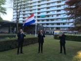 Drie trompetten Seniorenorkest Tilburg spelen taptoe, speciaal voor senioren van Het Laar