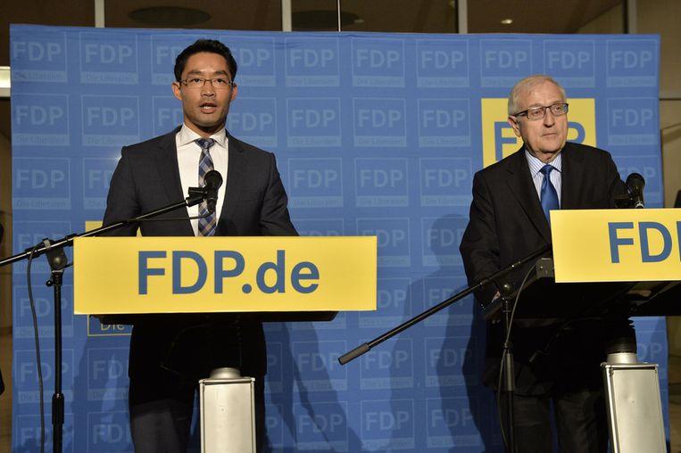 FDP-voorzitter Rösler en kopman Rainer Brüderle. Beeld AP