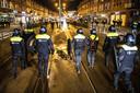 2021-01-26 21:11:11 ROTTERDAM - Politie-agenten op straat.  ANP