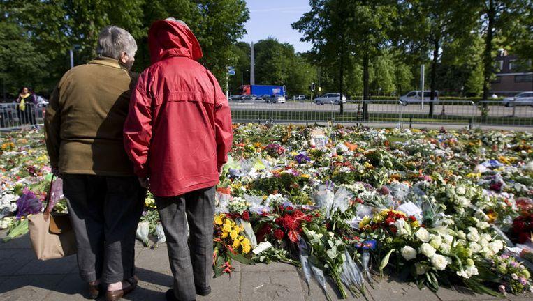 De bloemenzee die vorig jaar ontstond na de aanslag van Karst T. op Koninginnedag in Apeldoorn. Archieffoto ANP Beeld