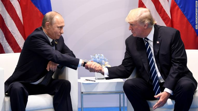 Russisch president Vladimir Poetin en Amerikaans president Donald Trump. Beeld RV