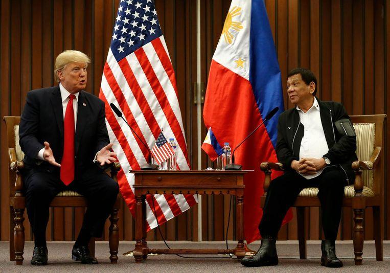 De Amerikaanse president Trump en zijn collega Duterte bij een eerdere ontmoeting. Beeld epa