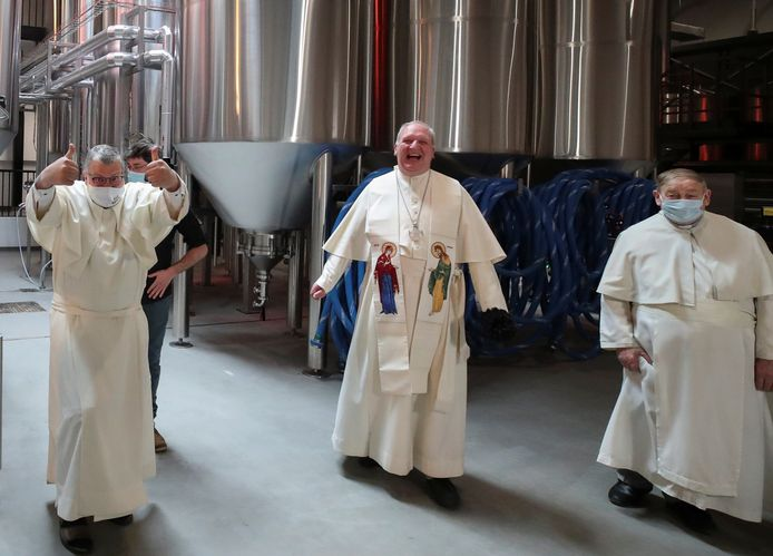 Father Karel Stautemas, abbot Erik De Sutter and father Stefaan Verstraeten react after blessing beer tanks at the Belgian Abbey of Grimbergen, which returns to brewing after a break of more than 200 years with a new microbrewery in Grimbergen, Belgium May 26, 2021. Picture taken May 26, 2021. REUTERS/Yves Herman