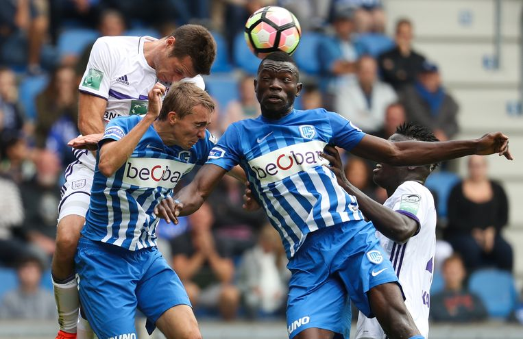Anderlecht's Uros Spajic, Genk's Timothy Castagne, Genk's Omar Colley and Anderlecht's Kara Mbodji fight for the ball during the Jupiler Pro League match between KRC Genk and Sporting Anderlecht, in Genk, Sunday 18 September 2016, on the seventh day of the Belgian soccer championship. BELGA PHOTO VIRGINIE LEFOUR Beeld BELGA