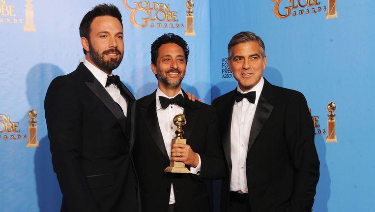 'Argo'-regisseur Ben Affleck, producer Grant Heslov en producer George Clooney Beeld GETTY