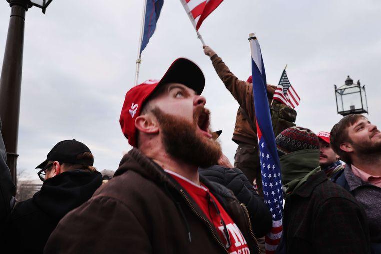 Een uitzinnige Trump-fan tijdens de bestorming van het Capitool op 6 januari.  Beeld AFP