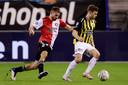 Bart Nieuwkoop (links) in actie tegen Vitesse.