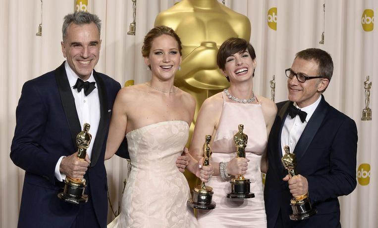 Beste Acteur Daniel Day Lewis, Beste Actrice Jennifer Lawrence, Anne Hathaway (Beste Vrouwelijke Bijrol) en Christophe Waltz (Beste Mannelijke Bijrol). Beeld EPA