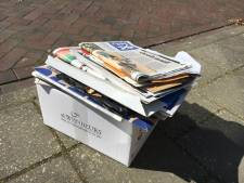 Avondklok: zet oud papier eerder aan de straat