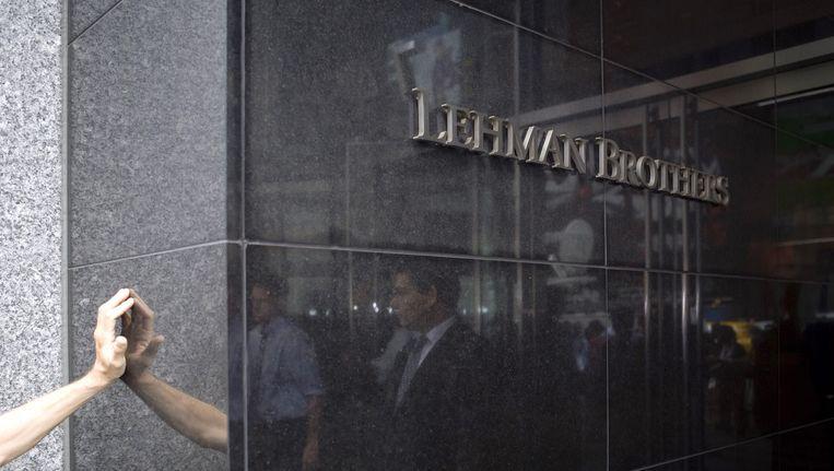 Het failliet van de Amerikaanse bank Lehman Brothers was het startpunt van de economische en financiële crisis. Beeld AFP