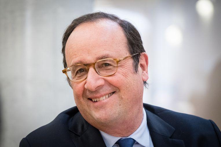 François Hollande in zijn nieuwe rol als spreker voor studenten en sociaal geëngageerde burgers. Beeld BELGAIMAGE