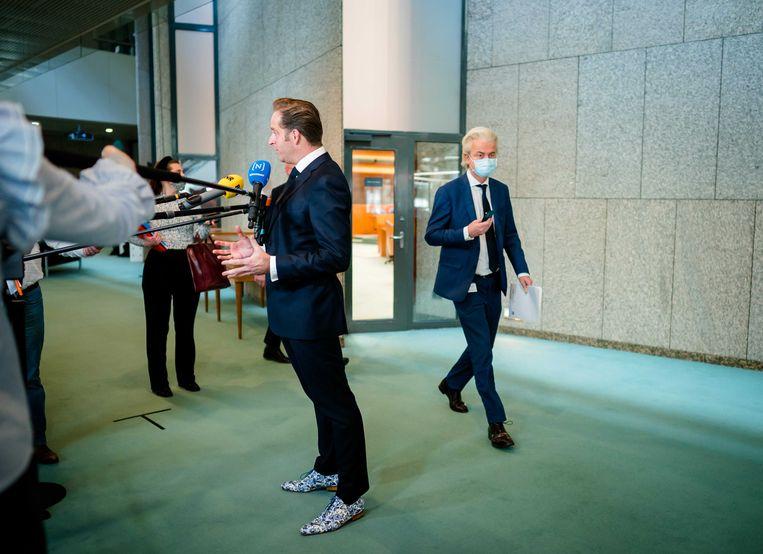 Minister Hugo de Jonge van Volksgezondheid, Welzijn en Sport (CDA) en Geert Wilders (PVV)  tijdens het wekelijks vragenuur in de Tweede Kamer. Beeld ANP