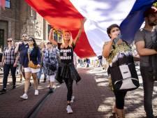 Coronabetogers op de Dam: 'Ik voel me vreemd, niet veilig en buitengesloten'