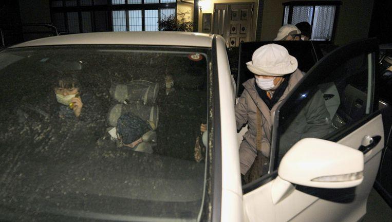 Inwoners van Iwaki, in het noorden van Japan, worden geëvacueerd vanwege de derde explosie in de centrale van Fukushima van vannacht. Beeld ap