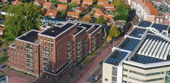 Zo komt het Posthuys tegenover het (witte) stadhuis in Spijkenisse eruit te zien.