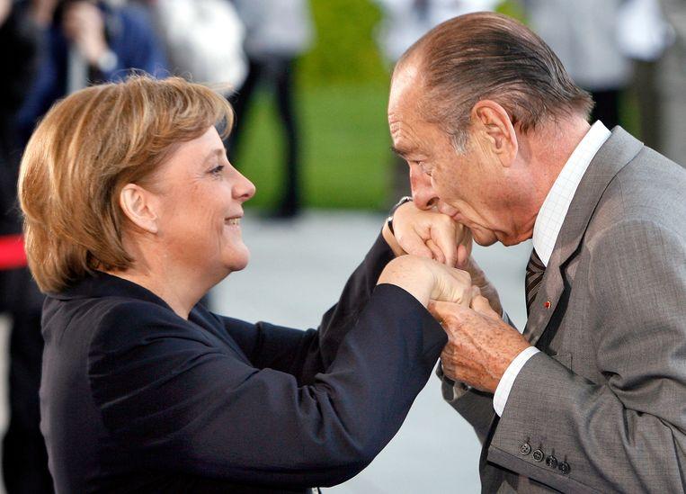 Met Duits bondskanselier Angela Merkel in 2007. Beeld AP