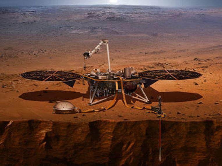 Impressie van InSight en zijn seismometer, aan het werk op Mars. Beeld Nasa